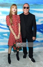 NEW YORK, NY - SEPTEMBER 12: Lisa of Blackpink (L) and Michael Kors pose backstage during the Michael Kors Collection Spring 2019 Runway Show at Pier 17 on September 12, 2018 in New York City. (Photo by Dimitrios Kambouris/Getty Images for Michael Kors)