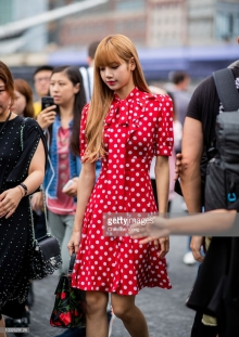 NEW YORK, NY - SEPTEMBER 12: Lisa Look wearing red dress with white dots print is seen outside Michael Kors during New York Fashion Week Spring/Summer 2019 on September 12, 2018 in New York City. (Photo by Christian Vierig/Getty Images)