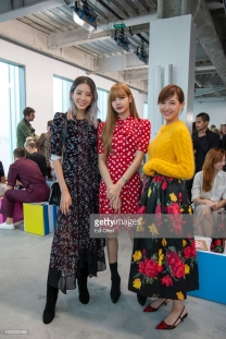 NEW YORK, NY - SEPTEMBER 12: (L-R) Irene Kim, Lisa of BlackPink and Tsubasa Honda attend the MICHAEL KORS COLLECTION Spring 2019 Runway Show, Asia Pacific Front Row Faces at Pier 17 on September 12, 2018 in New York City. (Photo by Edi Chen/Getty Images for Michael Kors)