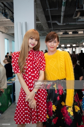 NEW YORK, NY - SEPTEMBER 12: Lisa of BlackPink (L) and Tsubasa Honda attend the MICHAEL KORS COLLECTION Spring 2019 Runway Show, Asia Pacific Front Row Faces at Pier 17 on September 12, 2018 in New York City. (Photo by Edi Chen/Getty Images for Michael Kors)